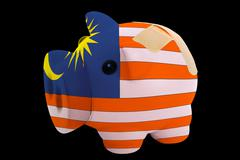 bankrupt piggy rich bank in colors of national flag of malaysia    closed wit - stock photo