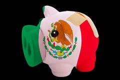 Bankrupt piggy rich bank in colors of national flag of mexico    closed with  Stock Photos