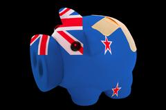 bankrupt piggy rich bank in colors of national flag of new zealand    closed  - stock photo