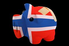 bankrupt piggy rich bank in colors of national flag of norway    closed with  - stock photo