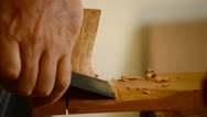 Stock Video Footage of Luthier with chisel making a guitar mastil, close up