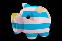 Bankrupt piggy rich bank in colors of national flag of uruguay    closed with Stock Photos