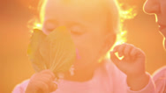 Stock Video Footage of Happy mother with little daughter at sunset (close-up)