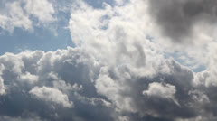 Dark clouds moving on blue sky - stock footage