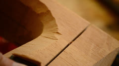 Craftsman with chisel working in wood, close up Stock Footage