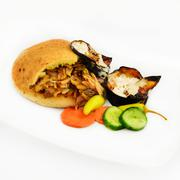 Shawarma in pita with scorched eggplant Stock Photos