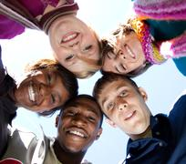 Faces of smiling multi-racial college students Stock Photos