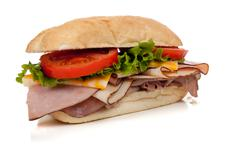 ham and turkey sandwich on a hoagie bun on white - stock photo