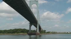 Sailing under the Bronx-Whitestone Bridge Stock Footage