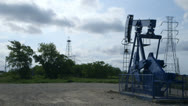 Stock Video Footage of wide shot oil pumpjack