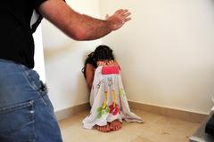 young girl suffers from domestic violence - stock photo