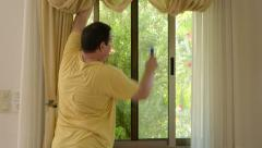 Man cleaning window Stock Footage