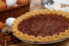 homemade pecan pie with ingredients - stock photo