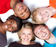 close-up faces of multi-racial college students - stock photo