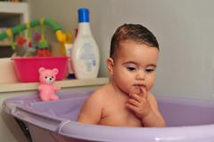 cute baby bathtime - stock photo