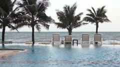 Swimming pool seaside of luxury hotel. - stock footage