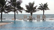 Stock Video Footage of Swimming pool seaside of luxury hotel.