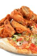 Pizza and chicken wings Stock Photos