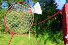 playing badminton outdoors - stock photo