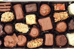 Chocolate candies in the box Stock Photos