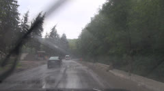 By car on mountain roads in rain Stock Footage