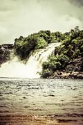 waterfall and the lagoon of canaima national park - venezuela - stock photo