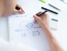 Calculating sales earnings Stock Photos