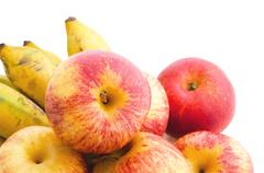 bunch of cultivated banana and apples - stock photo