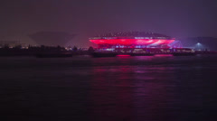 Watercraft traffic at night outside the Stadium - stock footage
