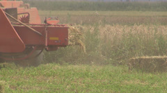Farmers in  field, Tractor makes bales of straw Stock Footage