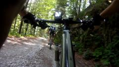 Mountainbiker riding down dirt road Stock Footage