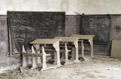 abandoned desks - stock photo