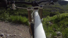 Mountainbiker riding downhill at high speed Stock Footage