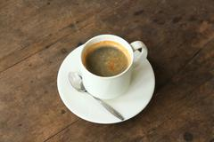 coffee cup, hot americano coffee on a table. - stock photo
