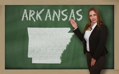 Teacher showing map of arkansas on blackboard Stock Photos