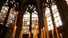 Stained glass with candles - stock footage