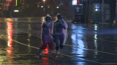 People Walk Along Street In Hurricane Stock Footage