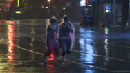 Stock Video Footage of People Walk Along Street In Hurricane