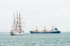 sailing vessel and modern oil tanker ship - stock photo