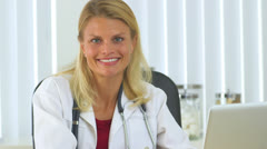 Successful woman doctor - stock footage