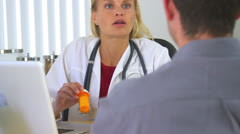 Female doctor prescribing medication to patient - stock footage