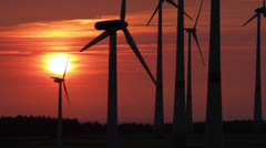 Several wind generators in sunset lighting Stock Footage