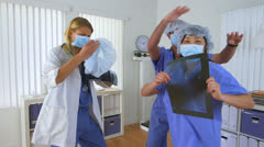 Doctors dancing in the office Stock Footage