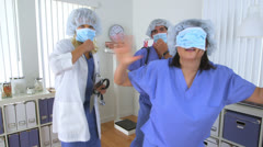 Doctors having fun in the office Stock Footage