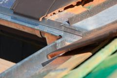 close-up of a newly installed gutter - stock photo