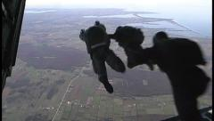 Military, Paratroopers jumping from plane - stock footage