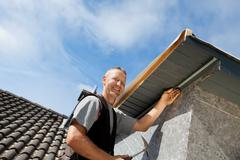 roofer assembling parts of the dormer - stock photo