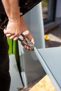roofer making cuts on a metal sheet - stock photo