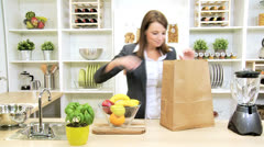 Smart Business Lady Unpacking Shopping Bag Fruit - stock footage
