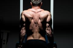 Stock Photo of young male bodybuilder doing heavy weight exercise